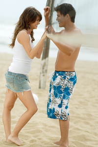 two people flirting on the beach