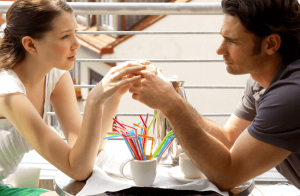 a woman meeting her ex boyfriend over coffee